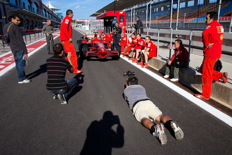 Rainer takes photos whilst Ferrari mechanics wait for FIA scrutineering in the evening
